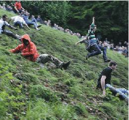 Olympic Cheese Rolling ? More fun than a bath tub of Cheez Whiz!